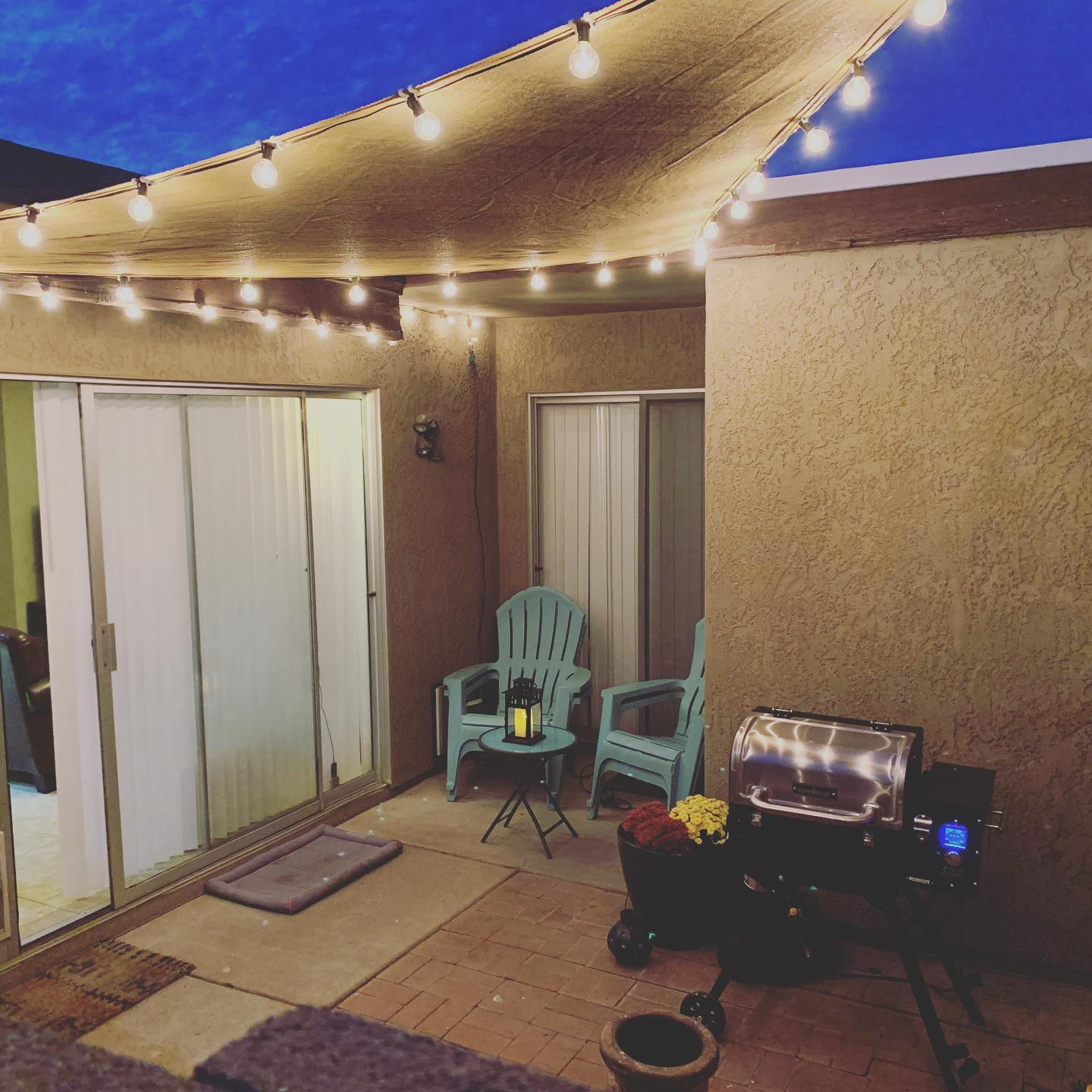 Cozy patio. Cozy smoker. Cozy plants.